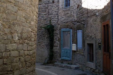 Street of old houses in ancient centre of Aigne