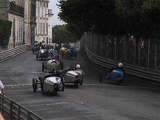 Three wheeled classic cars racing in Angouleme
