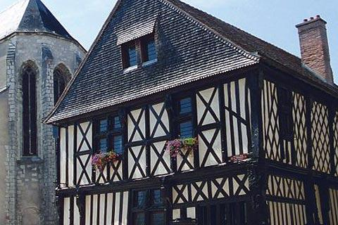 medieval house next to the church in Aubigny-sur-Nere