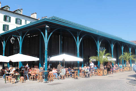 Market hall with restaurants on the banks of the Nive river