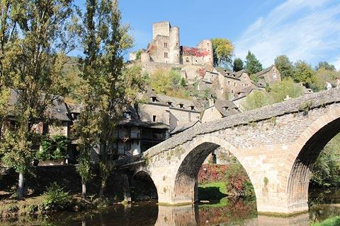Castle on the hill behind the bridge in Belcastel