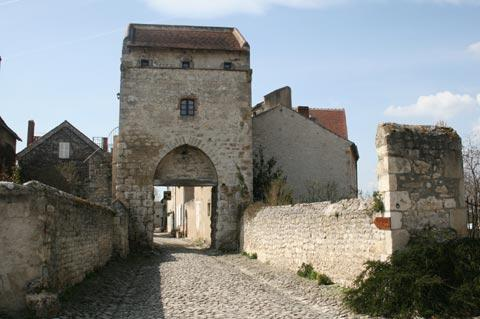 Stone gateway leading to historic centre of Charroux