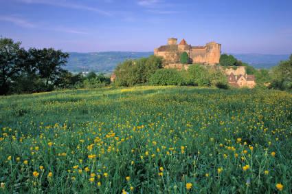 View across the fields to Chateau de Castelnau-Bretenoux