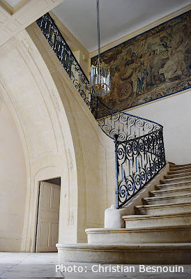 Grand staircase in the castle at Haras du Pin