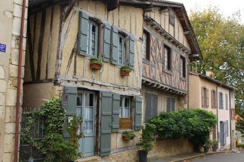 Colombage houses quiet street in Labastide d'Armagnac