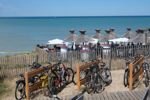 View of ocean with bikes and cafe in Lacanau Ocean