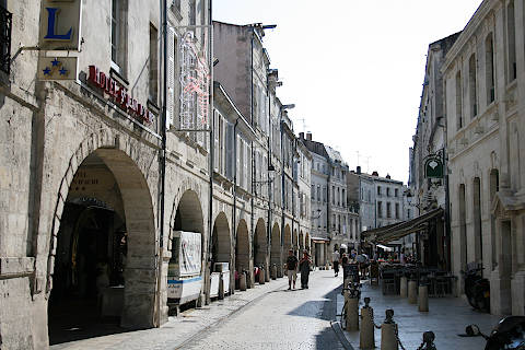 Street of arcades and shops in La Rochelle