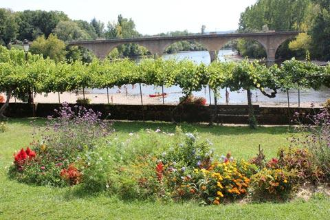 view of river and public gardens in Limeuil