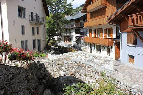 Stone bridge and traditional houses in Megeve