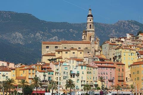 View from harbour of church and houses in Menton