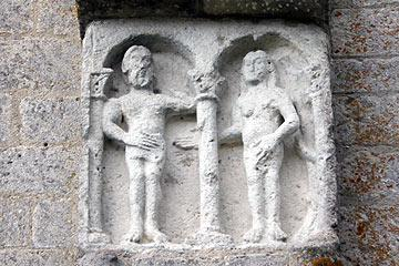 medieval stone carving on church wall in Montcaret