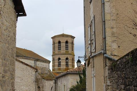 view across rooftops of Montcuq to church belltower