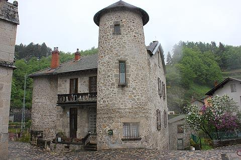 Ancient stone house and tower in Olliergues