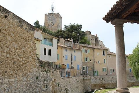 Colourful houses, ramparts and belfry in Pernes-les-Fontaines