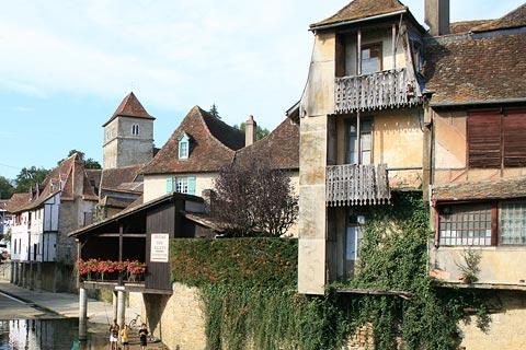 Old Houses Along River In Salies De Bearn