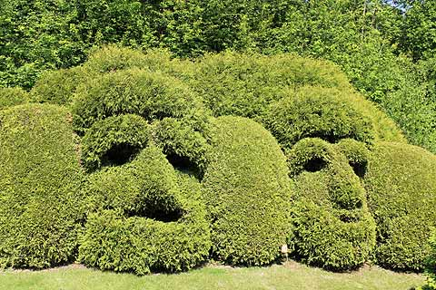 Topiary in the form of masks, Jardins de Sericourt