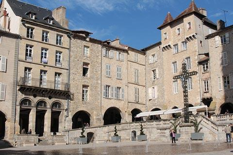Corner of Place Notre Dame in Villefranche-de-Rouergue with fountains and cafe